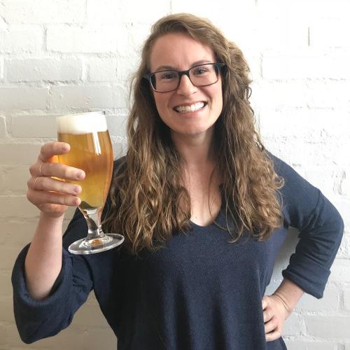 Natalya Watson holding a beer
